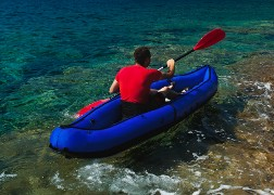 Man rowing in inflatable kayak at Adriatic sea. Hvar, Croatia © Evgeniya Moroz - Fotolia.com